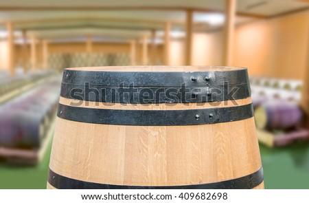 Closeup of wine barrels at a wine distillery - stock photo
