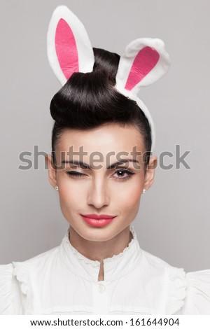 closeup of winking bunny girl face - stock photo