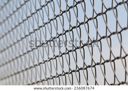 Closeup of wire mesh fence with selective focus - stock photo