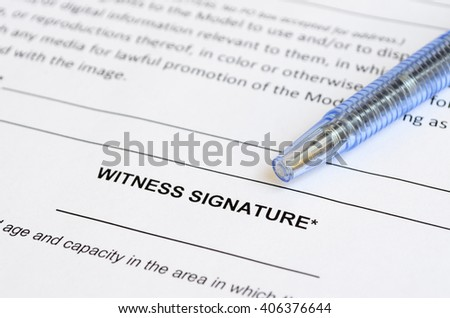 Closeup of witness signature area on a document with artistic shallow depth of field.