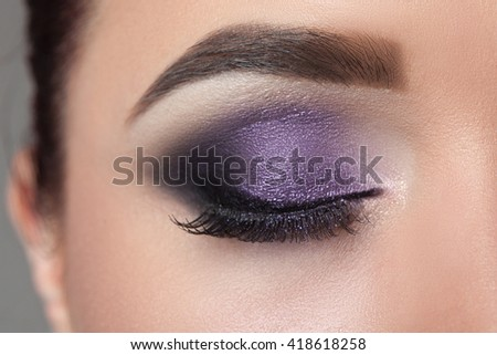 Closeup of woman eyes with beautiful fashion makeup.