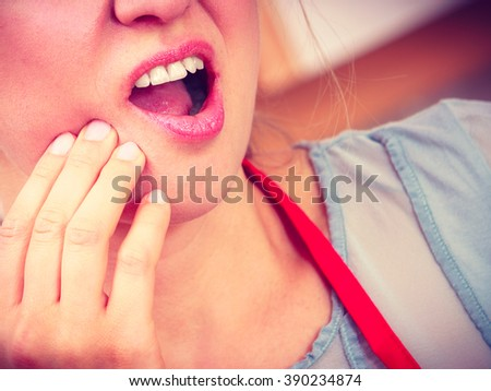 Closeup of woman female suffering from toothache tooth pain. - stock photo