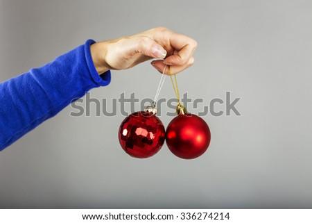 Closeup of woman hand holding christmas balls, conceptual image - stock photo