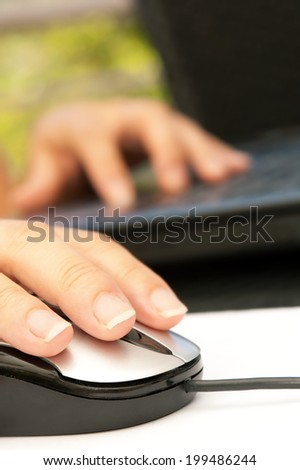Closeup of woman hand holding mouse
