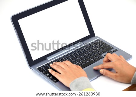 Closeup of woman hands typing on laptop keyboard