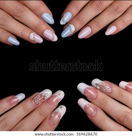 Closeup of woman hands with nail design. Trendy crackle nail polish. Manicure and nail tattoo trend. Closeup of woman hands on black background. Fashion Stylish Fashion Colorful Nails. - stock photo