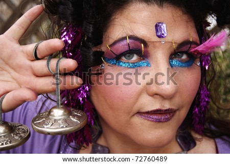 Closeup of woman in gypsy makeup - stock photo