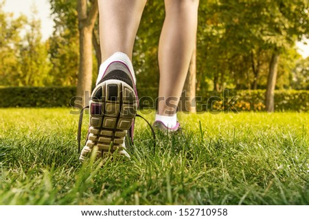 Closeup of woman legs and feet wearing shoes. - stock photo