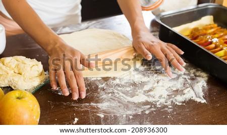 Closeup of woman making apple cake - stock photo