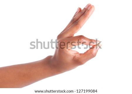 Closeup of woman's hand gesturing - showing ok sign, isolated on white background - stock photo