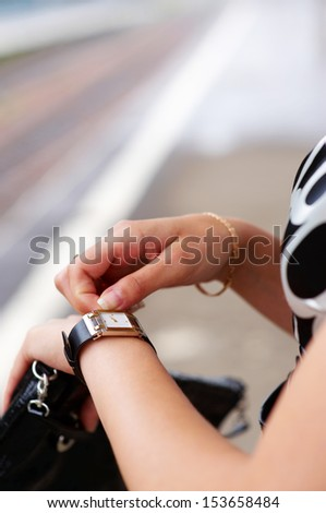 Closeup of woman's hand with watch she checking the time - stock photo