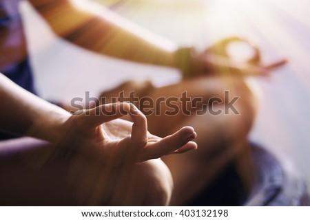 Closeup of woman's hands meditating indoors - stock photo