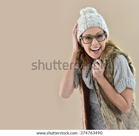 Closeup of woman wearing winter clothes, isolated - stock photo