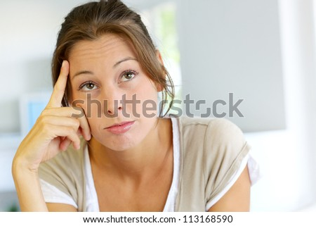 Closeup of woman with thoughtful look - stock photo