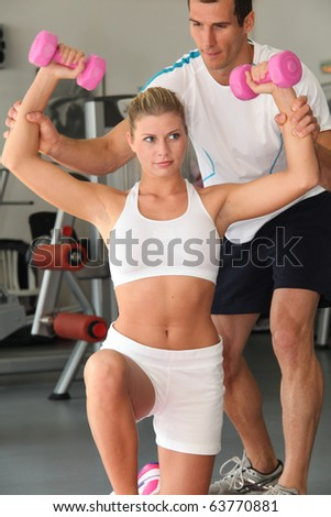 Closeup of woman working out in gym - stock photo