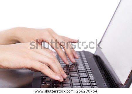 Closeup of women's hands touching type notebook (laptop) keys during work business isolated on white background. - stock photo
