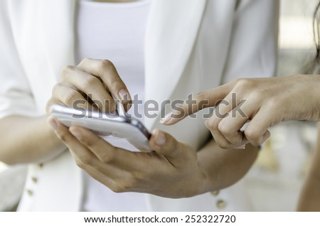 Closeup of women using tablet with stylus pen - stock photo