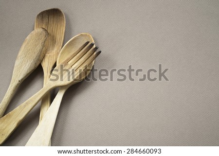 closeup of wooden cutlery on monochrome background. Copy space