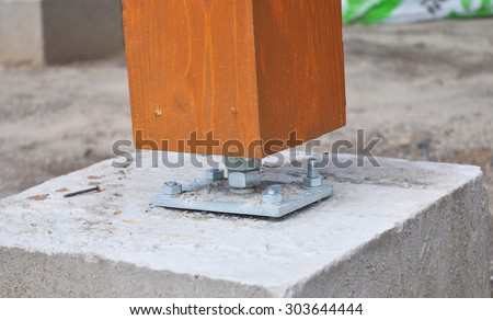 Closeup of wooden pillar on the construction site with screw. Wooden Pillars are structures that can be placed on Foundations or Platforms. - stock photo