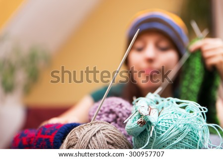 closeup of wool with a woman in the background