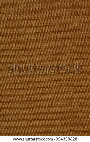 Closeup of woven tweed in tones of red, orange, and brown, for use as an advertisement backdrop/message, or for use as wallpaper. - stock photo