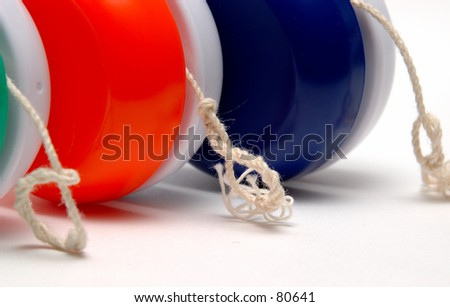 Closeup of Yo Yo's and Strings - stock photo