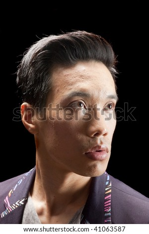 closeup of young asian man looking to right of screen