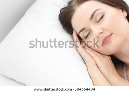 Closeup of young attractive woman sleeping in bedroom