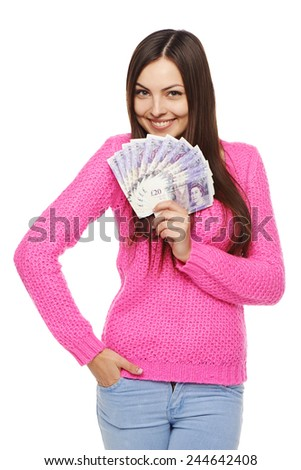 Closeup of young beautiful woman with British pounds in hand - stock photo
