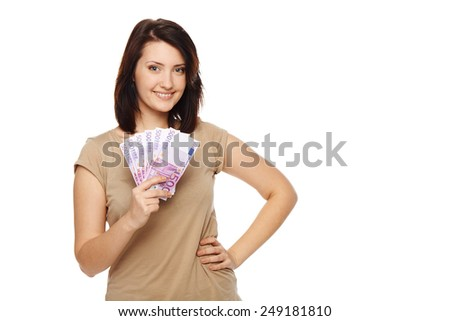 Closeup of young beautiful woman with euro money in hand - stock photo