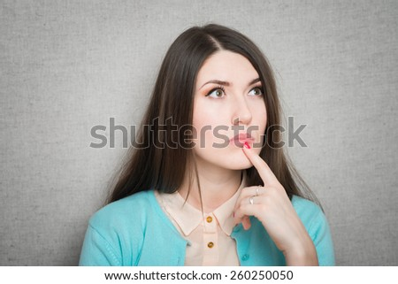 Closeup of young business woman pointing at copy space - stock photo