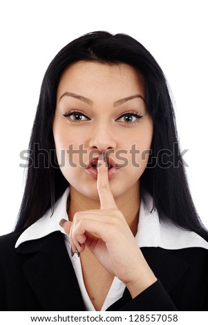 Closeup of young businesswoman making silence sign isolated on white background