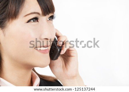 Closeup of  young businesswoman talking on the phone
