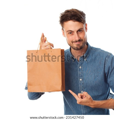 closeup of young cool man with the paper bag - stock photo