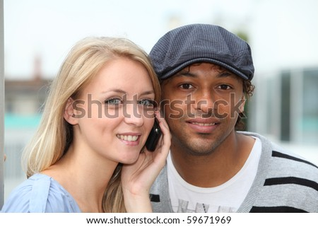 Closeup of young couple with telephone - stock photo