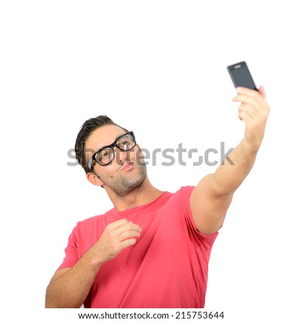 Closeup of young handsome man looking at smartphone and taking selfie - stock photo