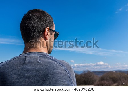 Closeup of young male staring at horizon