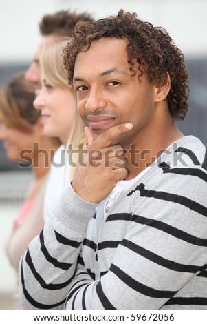 Closeup of young mix-raced man - stock photo