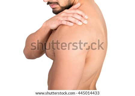 Closeup of young shirtless man with shoulder pain isolated in white background