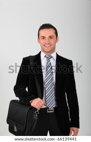 Closeup of young smiling salesman - stock photo