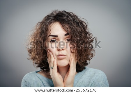 Closeup of young woman having a toothache - stock photo
