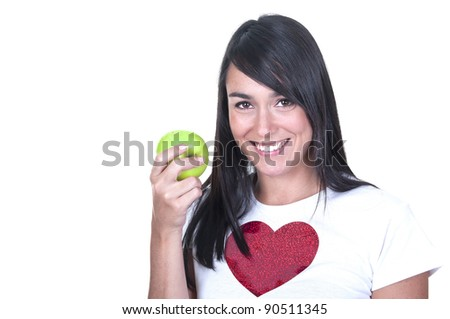 Closeup of young woman holding an apple over white background - stock photo