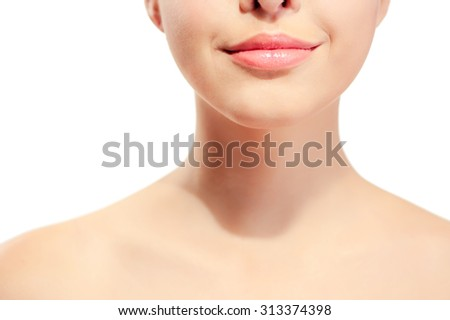 Closeup of young woman's pink lips and neck against white background - stock photo