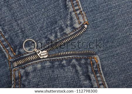 Closeup of zipper in blue jeans - stock photo