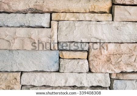 Closeup old stone brick wall texture background - stock photo