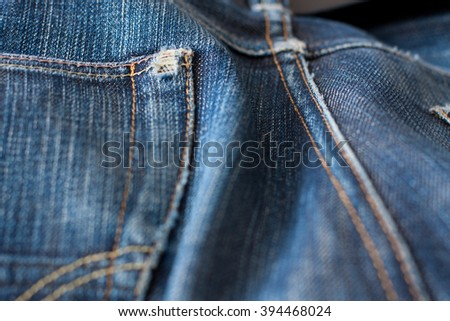 Closeup old washed denim texture - stock photo