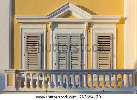 Closeup on a Balcony of a Neoclassic Building - stock photo