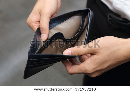 closeup on a businessman with empty wallet - stock photo