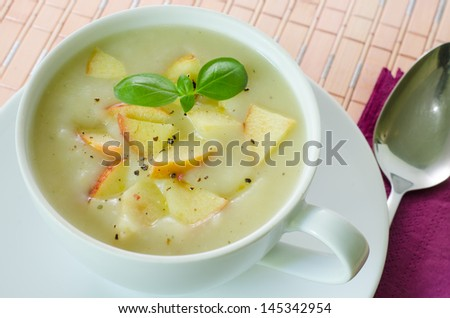 Closeup on a cup with potato and apple soup