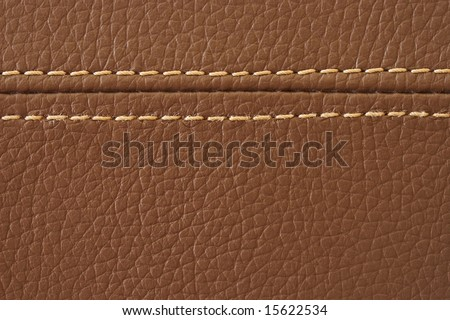 Closeup on a leather texture with a linear stitch - stock photo